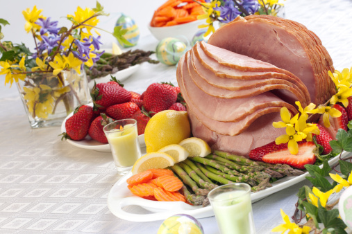 Easter ham with vegetables and fruits on the table