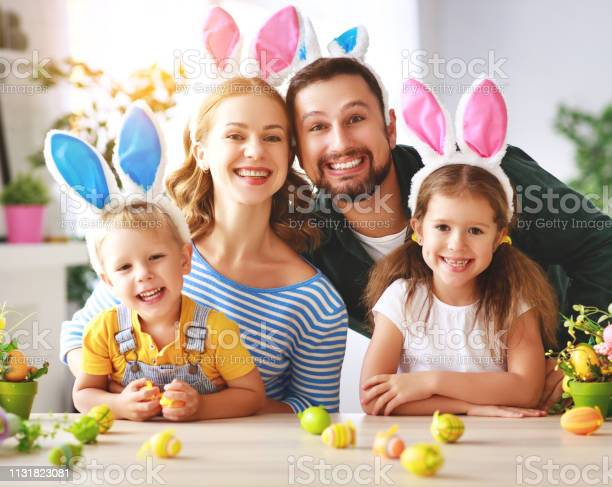Easter happy family mother father and children are preparing for picture id1131823081?b=1&k=6&m=1131823081&s=612x612&h=my1ouspqoczjxthmsjt2 uwes7jcadxd82wf0pgyp g=