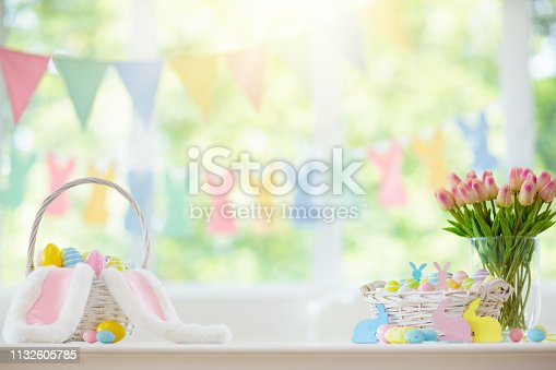 istock Easter home decoration. Eggs basket and bunny. 1132605785