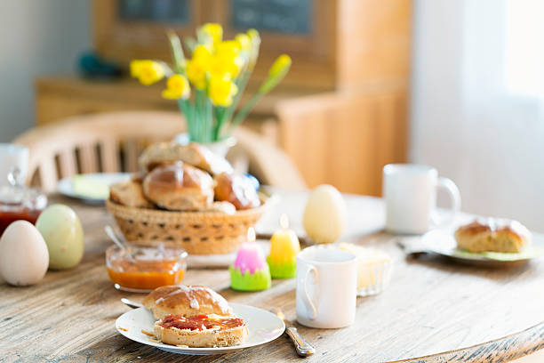 easter hot cross bun brunch - easter brunch stock photos and pictures