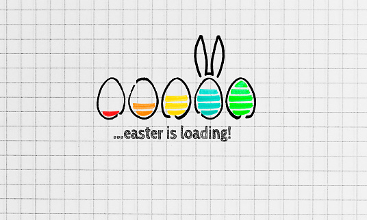 istock Easter is loading on notepad concept 1126718324