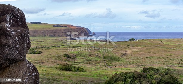 istock Easter Island Landscape. View frot seated moai to Tongariki 1298405158