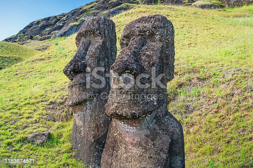 Easter Island Two Moai Statues side by side at Rano Raraku. Rano Raraku, Rapa Nui National Park, Hanga Roa, Easter Island, Chile.