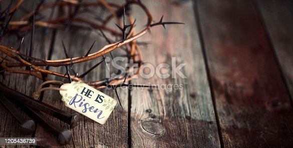 "Easter Jesus Crown of Thorns on an Old Wood Background with a Tag ""He Is Risen"""