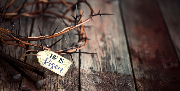 """Easter Jesus Crown of Thorns on an Old Wood Background with a Tag """"He Is Risen"""""""