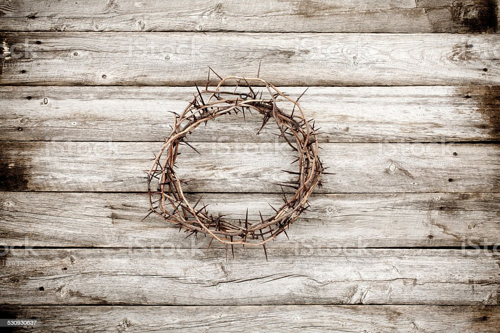 Easter Jesus crucifixion crown of thorns on rustic old wood stock photo