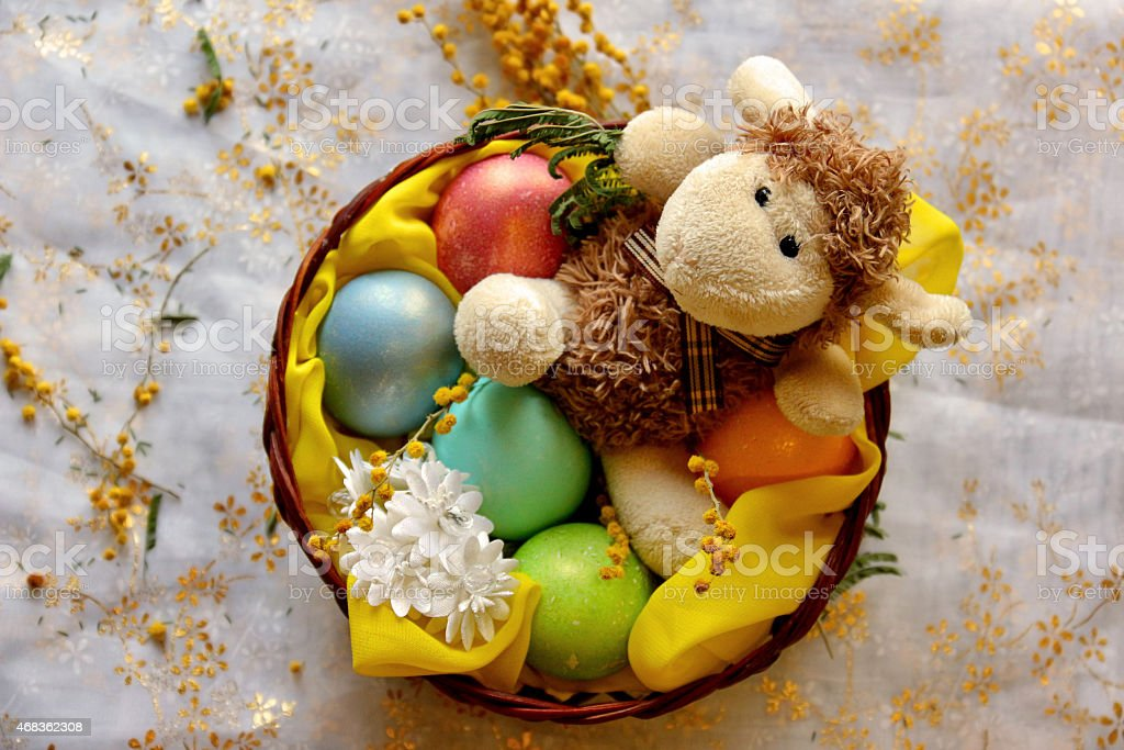 Easter lamb with colored pearly eggs in basket royalty-free stock photo