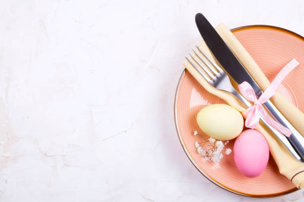 easter laying table appointments, table setting options. silverware, tableware items with festive decoration. fork, knife and flowers. happy easter holiday. - easter brunch stock photos and pictures