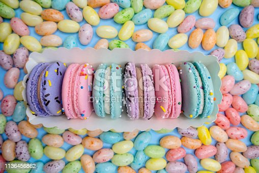 Beautiful macaron in a box with easter egg jelly beans.
