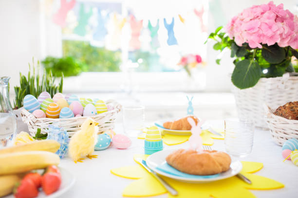 easter morning breakfast. eggs decor table setting - easter brunch stock photos and pictures