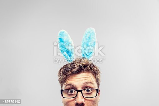 istock Easter Nerd with ears on looking at camera 467679140