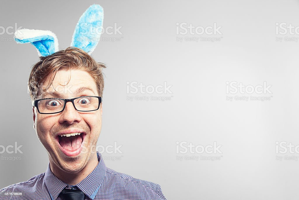 Easter nerd with rabbit ears in a photography studio stock photo