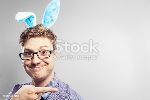 istock Easter nerd with rabbit ears in a photography studio 468264784