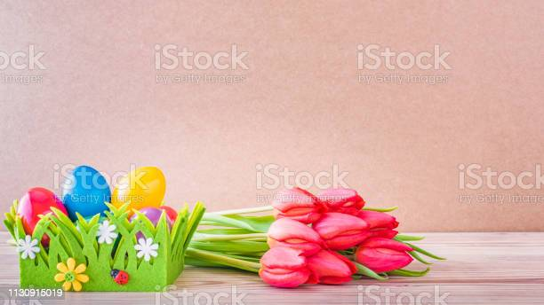 Easter nest with colourful easter eggs and red tulips picture id1130915019?b=1&k=6&m=1130915019&s=612x612&h=v0ydof9wxvsb8vw86xife2ywiq3mmh rvpn5bepnr w=