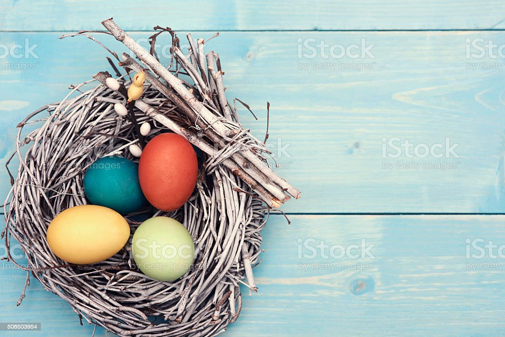 Easter nest with multi colorful eggs stock photo