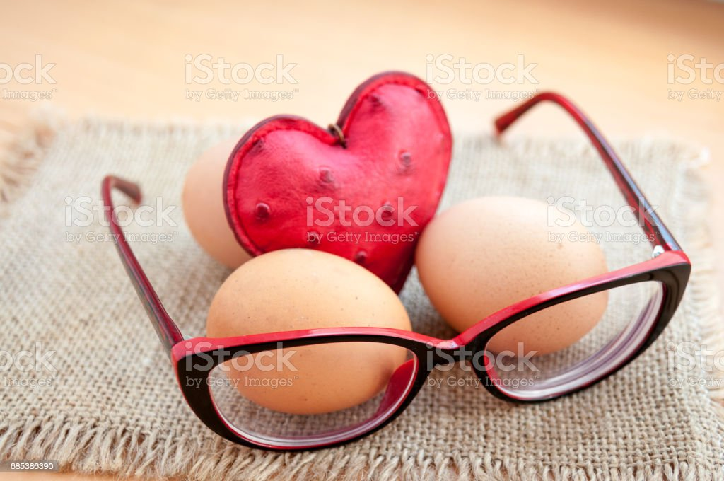 Easter, on a canvas napkin eggs, heart and glasses royalty-free stock photo