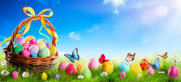 Easter - Painted Eggs In Basket On Grass With Sunny Spring Background stock photo