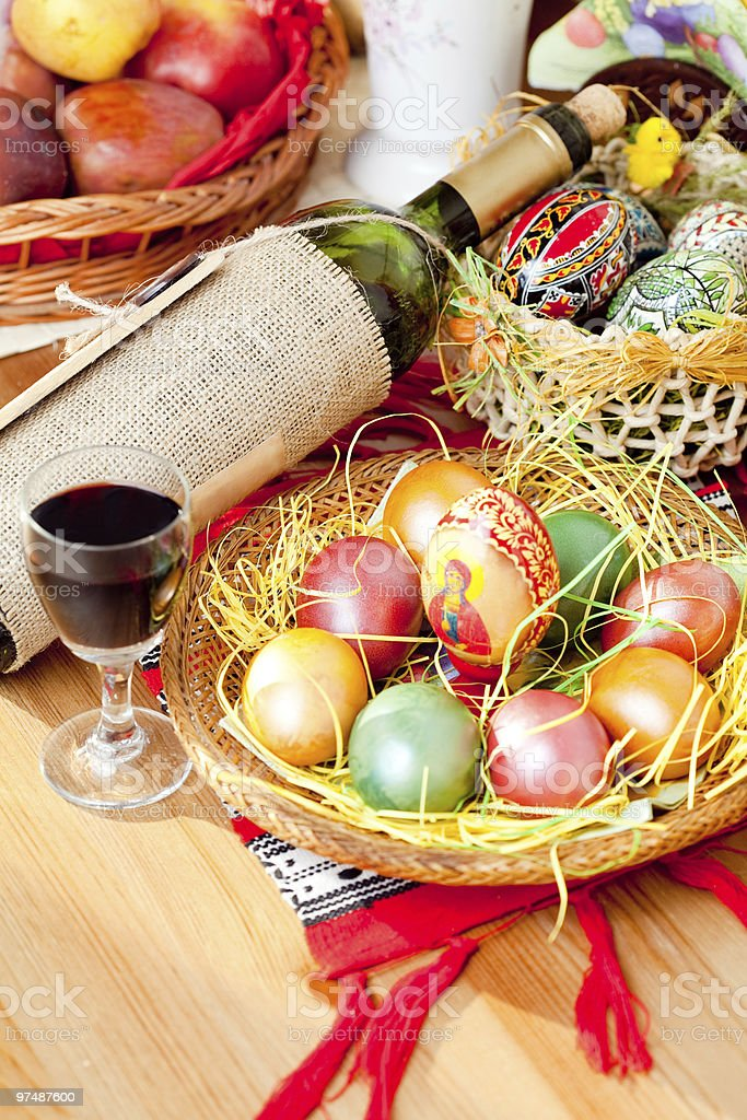 Easter painted eggs with wine bottle and glass royalty-free stock photo
