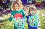 Kids full of joy and easter baskets full of eggs