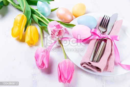 Easter table setting with spring flowers and Easter eggs
