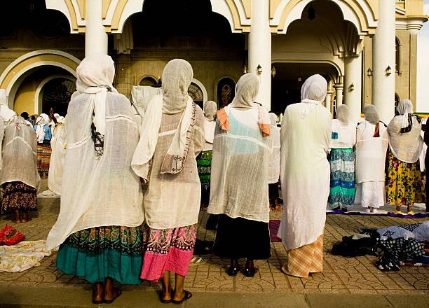 easter prayer, medhane alem church, addis abeba - religious celebration stock photos and pictures