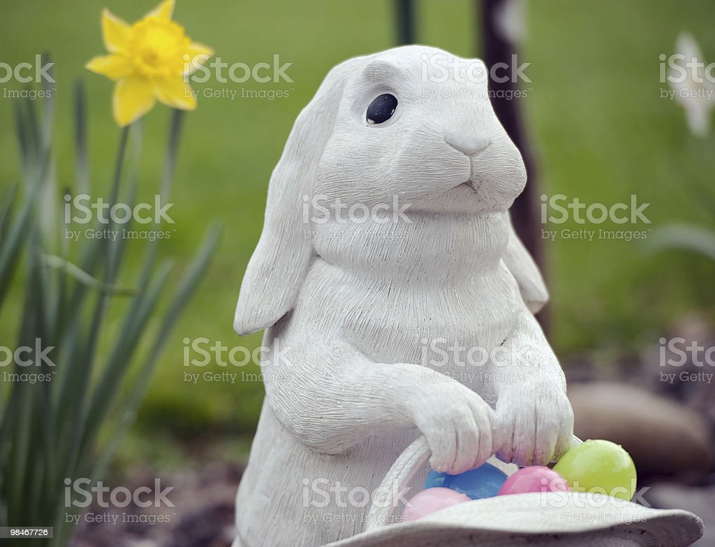 easter rabbit and basket of eggs royalty-free stock photo
