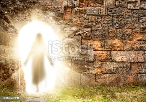 Easter. Resurrection. Stone wall with Jesus Tomb