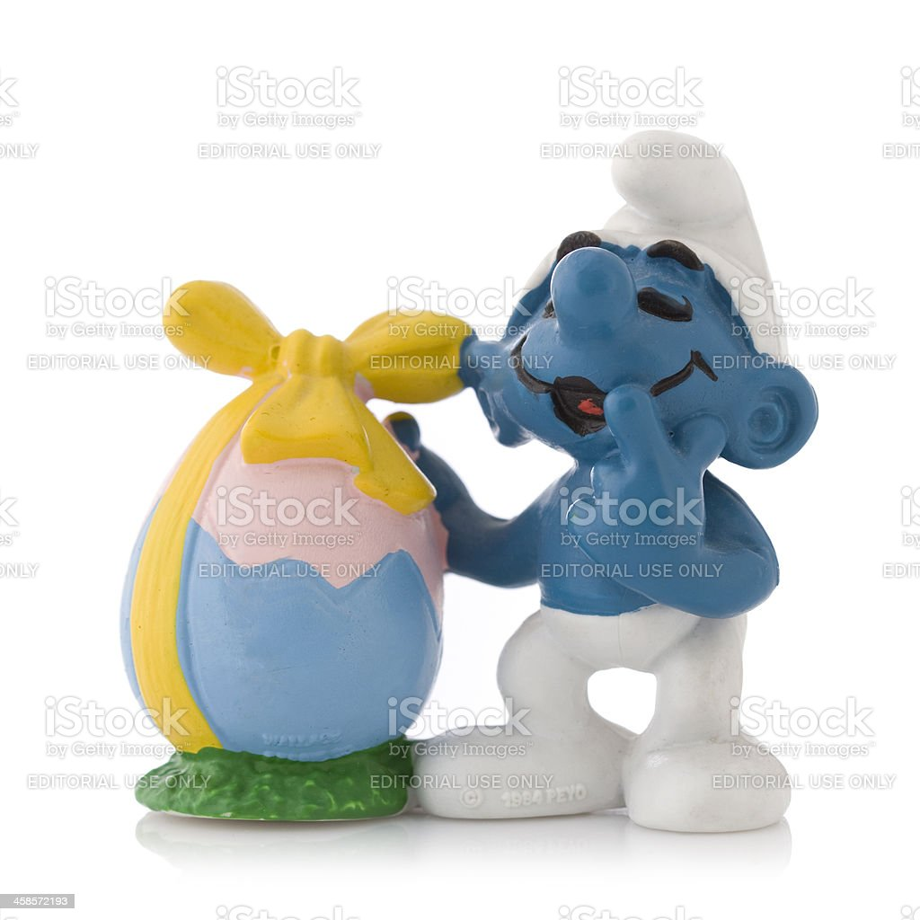Easter Smurf with egg stock photo