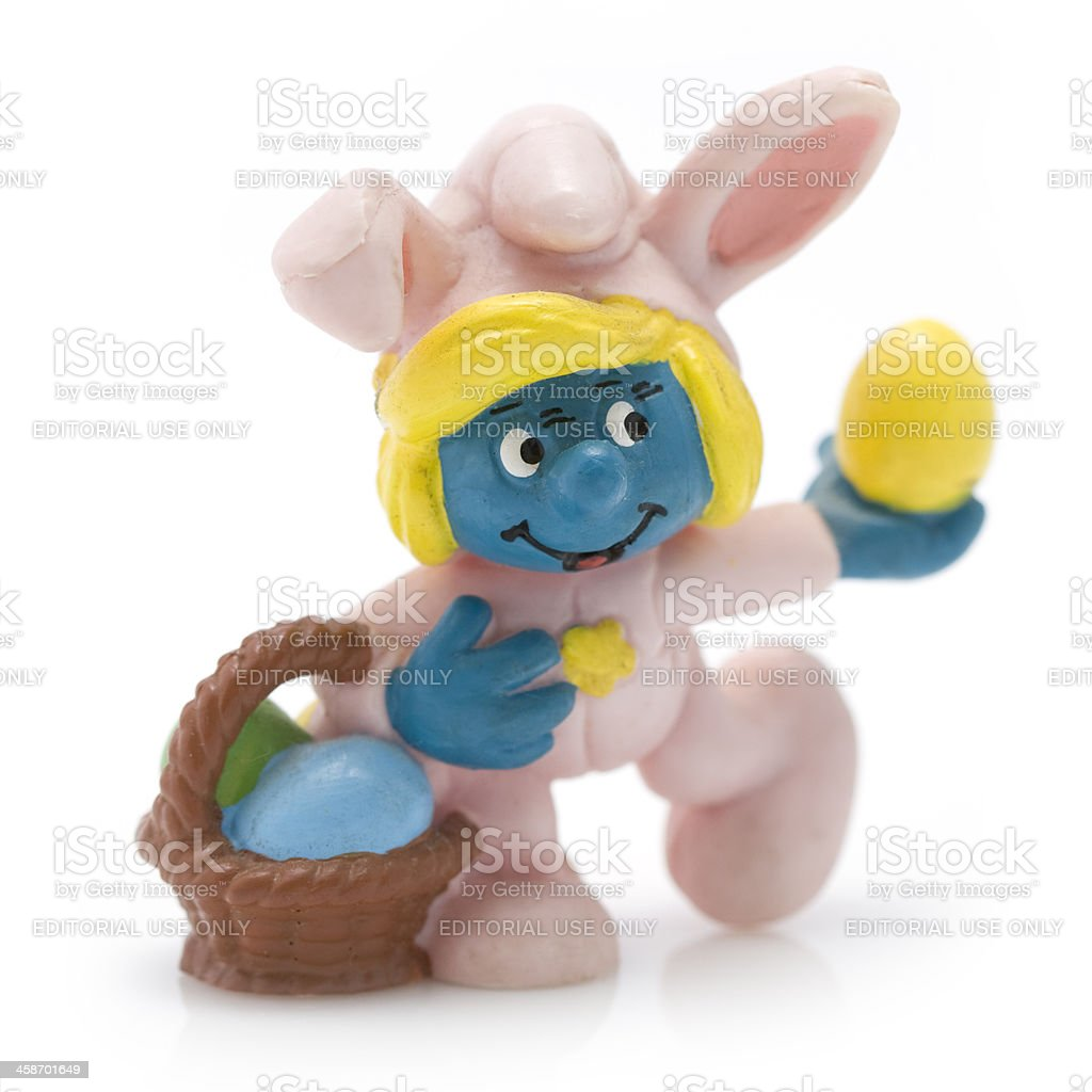 Easter Smurfette with basket royalty-free stock photo