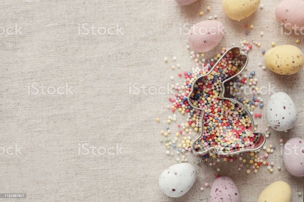 Easter speckled egg and bunny for kids background stock photo