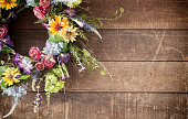 Easter spring flower wreath on an old rustic wood background