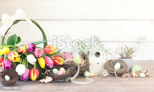 istock Easter Spring Tulips and Easter Eggs on an old White Wood Background 1095074624