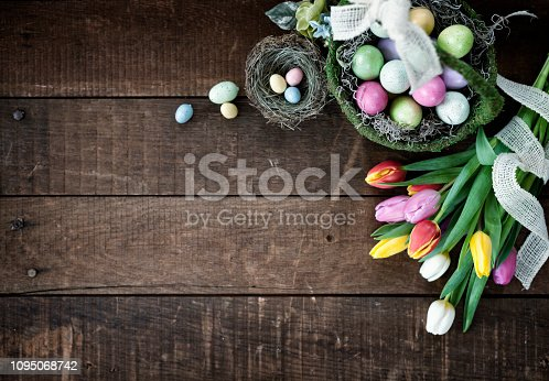 istock Easter Spring Tulips and Easter Eggs on an old Wood Background 1095068742
