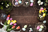 Easter Spring Tulips Frame on an old Rustic Wood Background