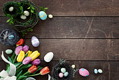 istock Easter Spring Tulips Frame Rustic Background 1299449647