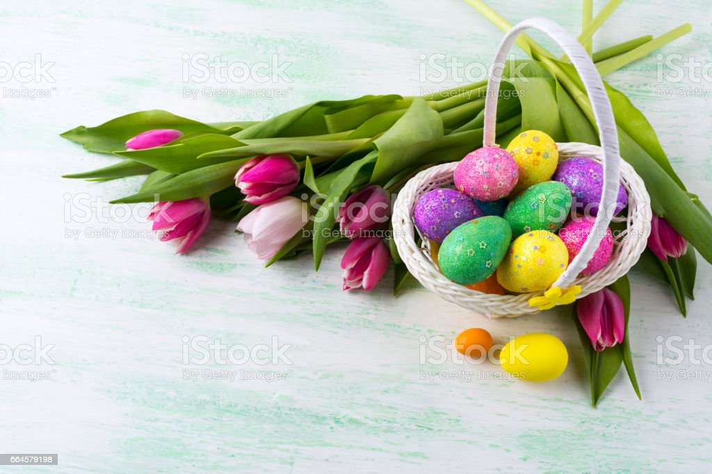 Easter star decorated glitter eggs in yellow wicker basket background. royalty-free stock photo