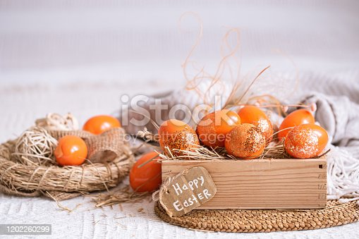 istock Easter still life with orange eggs, holiday decor . 1202260299