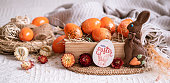 Easter still life with orange eggs, holiday decor . Easter cozy mood.