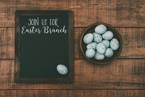 easter still life with speckled eggs and easter brunch message - easter brunch stock photos and pictures