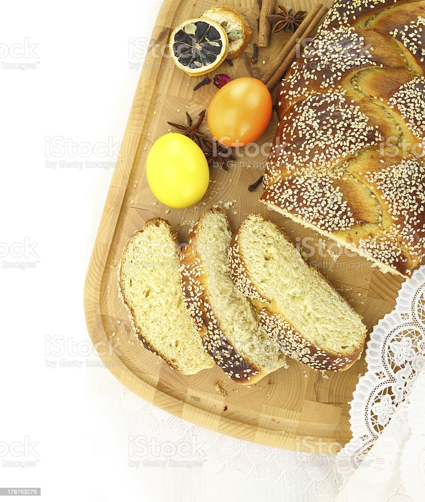 Easter sweet bread with multicolored eggs and shortbread cookies royalty-free stock photo
