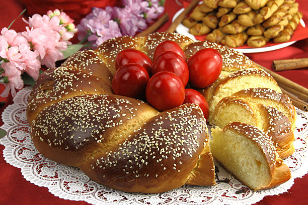 easter sweet bread with red eggs - greek easter stock photos and pictures