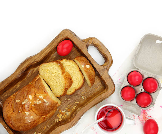 easter sweet brioche, red eggs and liquid dye - greek easter stock photos and pictures