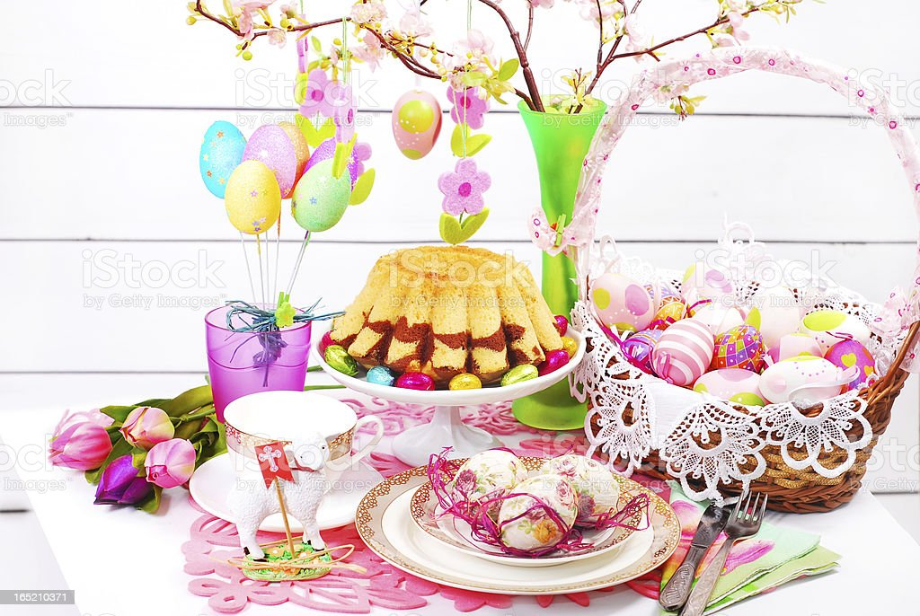 easter table decoration with ring cake and basket royalty-free stock photo