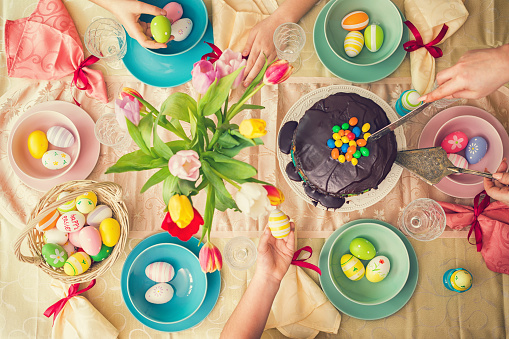 Overhead view on Easter table with family around