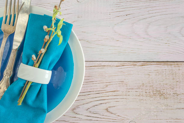 easter table setting - blue table setting stock photos and pictures
