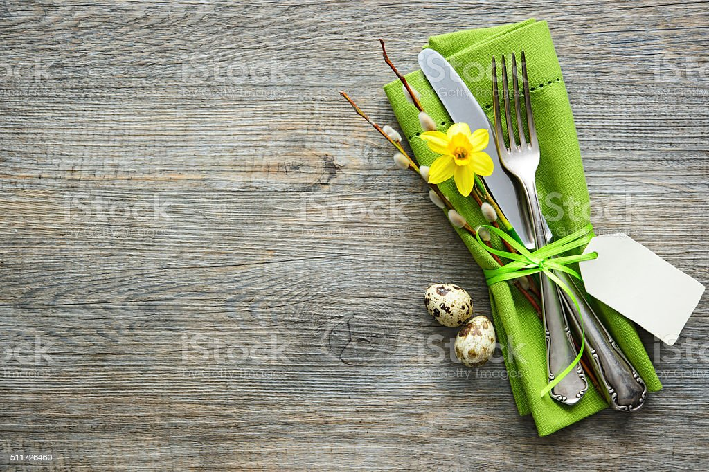 Easter table setting with daffodil and cutlery stock photo