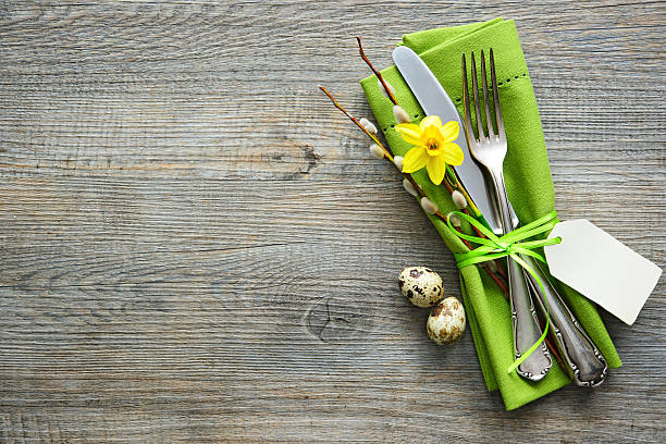 easter table setting with daffodil and cutlery - easter brunch stock photos and pictures