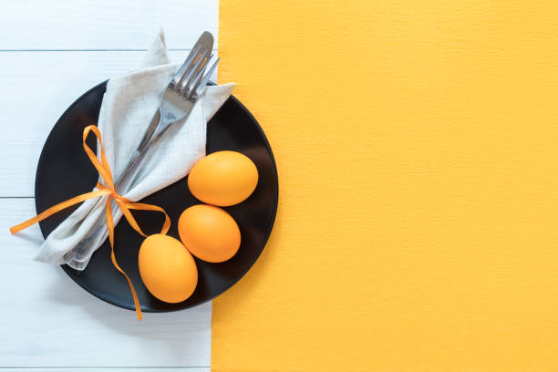 easter table setting with eggs and cutlery - easter brunch stock photos and pictures