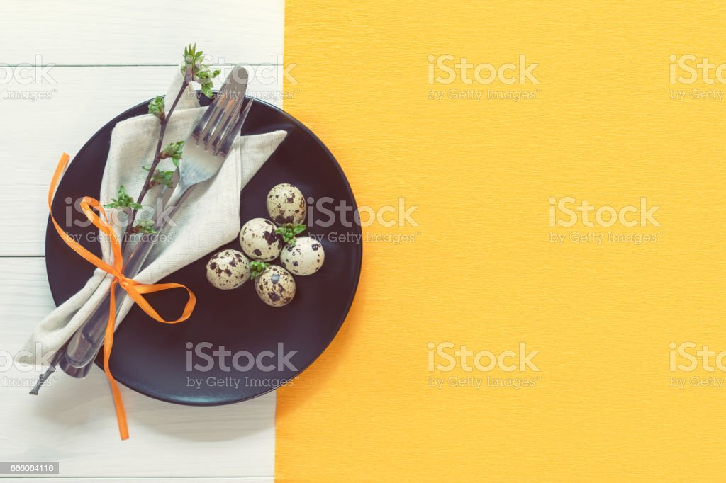 Easter table setting with eggs and cutlery stock photo