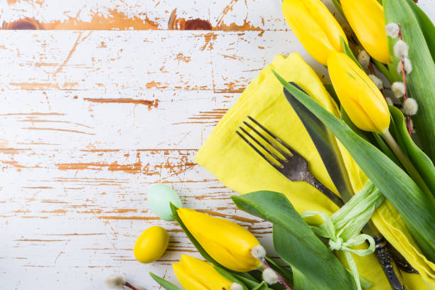 easter table setting with fluffy willow and tulips - easter brunch stock photos and pictures